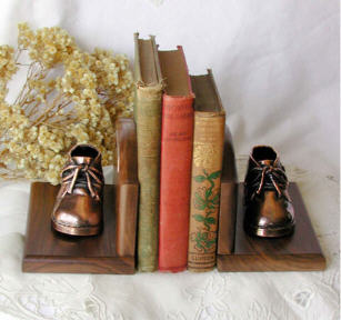 Bronzed shoes on walnut bookends