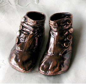 Bronzed baby shoes, unmounted antique buttontop booties